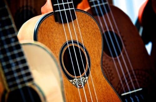 Three baritone ukuleles for learning to play the uke.